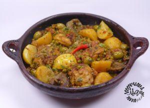 Tajine poulet, légumes, olives et citrons confits.